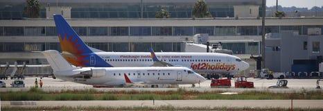 Επιβατηγά αεροσκάφη που σταθμεύουν στον αερολιμένα palma de Μαγιόρκα ευρέως στοκ εικόνα με δικαίωμα ελεύθερης χρήσης