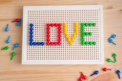 Επιγραφή αγάπης με τα στοιχεία μωσαϊκών Χαιρετισμός ημέρας βαλεντίνων ` s Στοκ Εικόνες