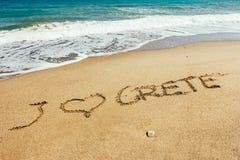 Επιγραφή της Κρήτης στην άμμο στοκ εικόνες