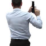 Επιθετικός επιχειρηματίας με ένα πυροβόλο όπλο Στοκ εικόνα με δικαίωμα ελεύθερης χρήσης