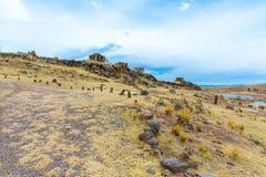 Επικήδειοι πύργοι σε Sillustani, προϊστορικές καταστροφές του Περού, νότια Αμερική Inca κοντά στην περιοχή λιμνών Titicaca. Στοκ Φωτογραφίες