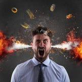 Επικεφαλής έκρηξη ενός επιχειρηματία έννοια της πίεσης λόγω της υπερκόπωσης στοκ φωτογραφίες με δικαίωμα ελεύθερης χρήσης