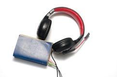 Επικεφαλής τηλέφωνο με το ακουστικό βιβλίο έννοιας βιβλίων Στοκ φωτογραφίες με δικαίωμα ελεύθερης χρήσης
