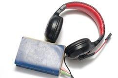 Επικεφαλής τηλέφωνο με το ακουστικό βιβλίο έννοιας βιβλίων Στοκ φωτογραφία με δικαίωμα ελεύθερης χρήσης
