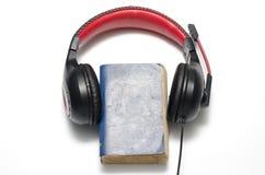 Επικεφαλής τηλέφωνο με το ακουστικό βιβλίο έννοιας βιβλίων Στοκ Φωτογραφία