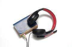 Επικεφαλής τηλέφωνο με το ακουστικό βιβλίο έννοιας βιβλίων Στοκ Εικόνες