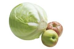 Επικεφαλής του λάχανου με δύο μήλα στοκ εικόνες