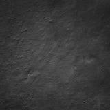 Επικονιασμένο τεμάχιο του τοίχου, που χρωματίζεται στο σκούρο γκρι χρώμα Στοκ εικόνες με δικαίωμα ελεύθερης χρήσης