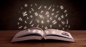 Επιστολές αλφάβητου πέρα από το βιβλίο Στοκ εικόνα με δικαίωμα ελεύθερης χρήσης