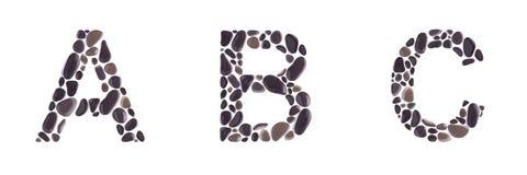 Επιστολές Α, Β και Γ φιαγμένες από πέτρες παραλιών που απομονώνονται στο άσπρο υπόβαθρο στοκ εικόνες