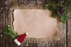 Επιστολή Χριστουγέννων, κατάλογος, συγχαρητήρια σε ένα ξύλινο υπόβαθρο ελεύθερου χώρου, νέο έτος προτύπων στοκ εικόνες
