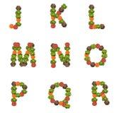 Επιστολές αλφάβητου που γίνονται από τα λαχανικά Στοκ Φωτογραφίες