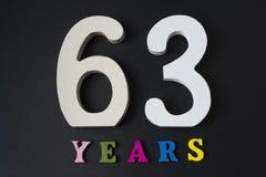 Επιστολές και αριθμός-εξήντα-τρία στο μαύρο υπόβαθρο Στοκ εικόνες με δικαίωμα ελεύθερης χρήσης