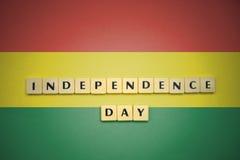 Επιστολές με τη ημέρα της ανεξαρτησίας κειμένων στη εθνική σημαία της Βολιβίας Στοκ φωτογραφίες με δικαίωμα ελεύθερης χρήσης