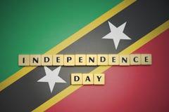 Επιστολές με τη ημέρα της ανεξαρτησίας κειμένων στη εθνική σημαία του St Kitts and Nevis Στοκ φωτογραφία με δικαίωμα ελεύθερης χρήσης