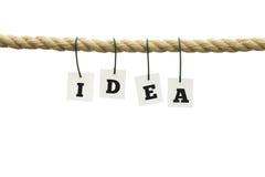 Επιστολές που συλλαβίζουν - ιδέα - που κρεμά σε ένα σχοινί Στοκ εικόνα με δικαίωμα ελεύθερης χρήσης