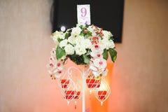 Επιτραπέζιος αριθμός στη στάση λουλουδιών Στοκ φωτογραφία με δικαίωμα ελεύθερης χρήσης
