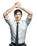 Επιτυχής επιχειρηματίας που κάνει τη χειρονομία νίκης στοκ εικόνα