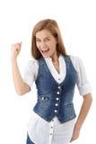 Επιτυχής νέα γυναίκα που χαμογελά ευτυχώς στοκ εικόνες
