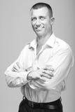 Επιτυχής νέος επιθετικός επιχειρηματίας ατόμων που φαίνεται ισχυρός και ομο Στοκ Εικόνα