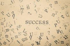 επιτυχία λέξης επιστολών αλφάβητου από την πηγή επιστολών γραμματοσήμων σε χαρτί FO Στοκ εικόνα με δικαίωμα ελεύθερης χρήσης