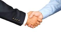 Επιτυχείς επιχειρηματίες που τινάζουν τα χέρια σε ένα άσπρο υπόβαθρο Στοκ φωτογραφία με δικαίωμα ελεύθερης χρήσης