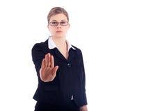 επιχείρηση που η σοβαρή γυναίκα στάσεων σημαδιών στοκ φωτογραφία