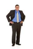 Επιχειρηματίας: Άτομο που στέκεται με τα χέρια στα ισχία Στοκ Εικόνες