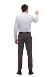 Επιχειρηματίας ή δάσκαλος με το δείκτη από την πλάτη Στοκ φωτογραφία με δικαίωμα ελεύθερης χρήσης