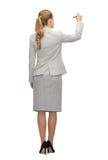 Επιχειρηματίας ή δάσκαλος με το δείκτη από την πλάτη Στοκ Φωτογραφία