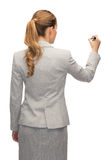Επιχειρηματίας ή δάσκαλος με το δείκτη από την πλάτη Στοκ Εικόνες