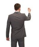 Επιχειρηματίας ή δάσκαλος με το δείκτη από την πλάτη Στοκ Εικόνα