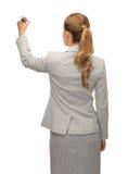 Επιχειρηματίας ή δάσκαλος με το δείκτη από την πλάτη Στοκ εικόνα με δικαίωμα ελεύθερης χρήσης