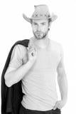 Επιχειρηματίας ή νεαρός άνδρας που φορά το καπέλο κάουμποϋ και το μαύρο σακάκι Στοκ φωτογραφία με δικαίωμα ελεύθερης χρήσης