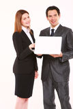 Επιχειρηματίας και επιχειρηματίας με το lap-top Στοκ Εικόνες