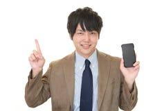 Επιχειρηματίας με ένα έξυπνο τηλέφωνο Στοκ Φωτογραφία