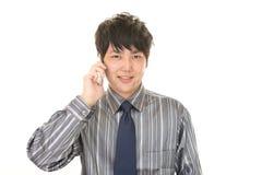 Επιχειρηματίας με ένα έξυπνο τηλέφωνο Στοκ Εικόνα
