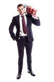 Επιχειρηματίας με ένα κόκκινο αλυσιδοπρίονο Στοκ φωτογραφίες με δικαίωμα ελεύθερης χρήσης