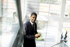 Επιχειρηματίας με ένα τηλέφωνο Στοκ Φωτογραφία