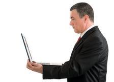 Επιχειρηματίας με ένα lap-top που απομονώνεται στο άσπρο υπόβαθρο Στοκ Εικόνα