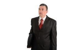 Επιχειρηματίας με ένα lap-top που απομονώνεται στο άσπρο υπόβαθρο Στοκ Φωτογραφίες