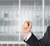 Επιχειρηματίας, με μια πράσινη μάνδρα Στοκ Εικόνες