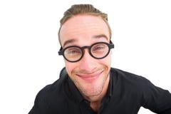 Επιχειρηματίας με τα γυαλιά ανάγνωσης που κάνει ένα πρόσωπο Στοκ Εικόνα