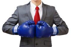 Επιχειρηματίας με τα μπλε εγκιβωτίζοντας γάντια Στοκ Φωτογραφίες