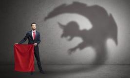 Επιχειρηματίας με την έννοια σκιών και toreador ΟΜΠ στοκ φωτογραφίες