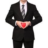 Επιχειρηματίας με την κόκκινη καρδιά που απομονώνεται στο λευκό συνδεδεμένο διάνυσμα βαλεντίνων απεικόνισης s δύο καρδιών ημέρας Στοκ φωτογραφία με δικαίωμα ελεύθερης χρήσης