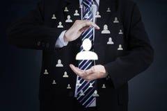 Επιχειρηματίας με την προστατευτική χειρονομία Στοκ Εικόνα