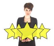 Επιχειρηματίας με την ταξινόμηση των αστεριών που απομονώνεται Στοκ Εικόνες