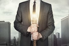 Επιχειρηματίας με τη λάμπα φωτός στοκ φωτογραφίες