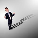 Επιχειρηματίας με τη σκιά ως σύμβολο χρημάτων Στοκ φωτογραφίες με δικαίωμα ελεύθερης χρήσης
